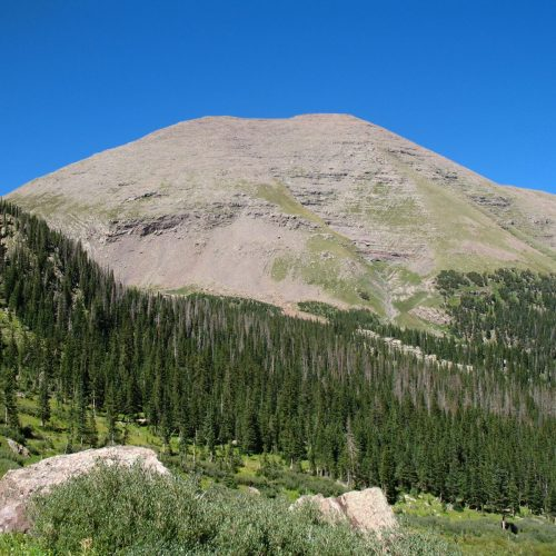 Humboldt Peak on a bright sunny day surrounded by trees